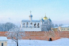 St. Sophia Cathedral in Veliky Novgorod, Russia - winter landscape. St. Sophia Orthodox Cathedral with the belfry in winter evening under falling snow in Veliky royalty free stock photos