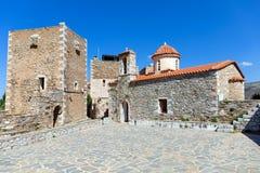 St. Spyridon and village square, Vatheia village, Mani, Laconia, Greece. Royalty Free Stock Photo