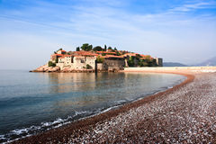 St. Stefan Island. Sveti Stefan island in Budva, Montenegro.  Silent morning with beautiful  azure sky Stock Photography