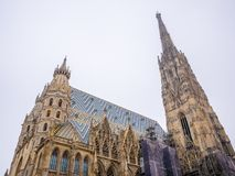 St. Stephen`s Cathedral in Vienna, Austria in a beautiful white background sky. stock image