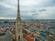St. Stephen`s Cathedral in Vienna, Austria. Roof and Cityscape in Background. Royalty Free Stock Photos