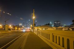 1st Street Bridge at night, Los Angeles. 1st Street Bridge at night in Los Angeles. We can also see the city hall building royalty free stock photography