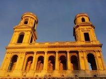 St Sulpice Church i Paris på solnedgången Arkivbild