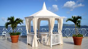 St. Thomas Beach. An elevated view of the ocean of the coast of St. Thomas, Virgin Islands, with a gazebo and ppalms inthe foreground and St. Johns Island in the Royalty Free Stock Photography