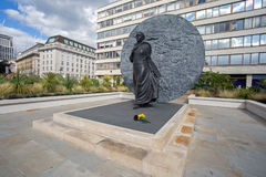 08/13/2017, St Thomas`s Hospital, London, England, A statue of black pioneer nurse, Mary Seacole with flowers left at the base. At St Thomas`s hospital grounds Royalty Free Stock Photo