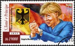 St. THOMAS UND PRINZ ISLANDS - 2015: Shows Angela Dorothea Merkel geboren 1955 und größeres Kaiserwappen von Deutschland Lizenzfreie Stockfotos