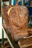 Cowboy boots in preparation at the factory Boulet in Canada stock photography
