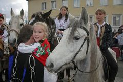 St. Todor 's day. Race with horses and horses pull carts with heavy logs on Todorov day. St. Todor 's day. Race with horses and horses pull carts with heavy Stock Photo