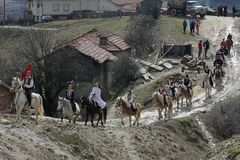 St. Todor 's day. Race with horses and horses pull carts with heavy logs on Todorov day. St. Todor 's day. Race with horses and horses pull carts with heavy Royalty Free Stock Photography