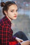 Söt tonårig flicka med tofsen av hår Fotografering för Bildbyråer