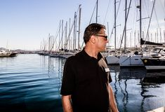 St. Tropez, France - 2019. Photographer working in the harbor of St. Tropez, French Riviera stock photo