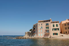 St Tropez seafront apartments. Seafront apartments at St Tropez, France on a hot summer day with bright colours Royalty Free Stock Photos