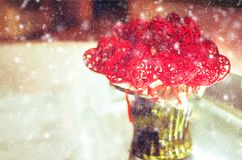 St. Valentine's Day greeting. Heart toy shapes in a vase outdoors snowing toned Royalty Free Stock Image