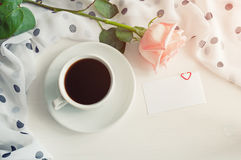 St Valentine day background in vintage tones - cup of coffee, rose, blank love card Royalty Free Stock Photos