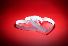 St. Valentine Day. Two hearts. On red background Royalty Free Stock Photo