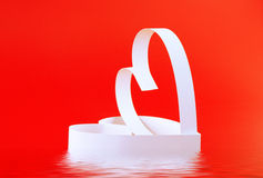 St. Valentine Day. Two hearts. On red background Stock Photo
