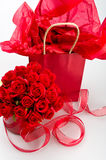 St. Valentine gifts. Saint Valentine presents with decorations of roses and ribbon Stock Photography