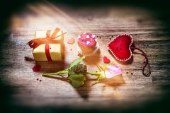 St Valentine`s concept with decorative hearts, pink rose and pre Royalty Free Stock Photography