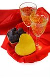 St. Valentine's day. Two glasses of wine with chocolates for Valentine's day on red textile isolated on white background Stock Images