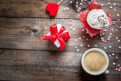St. Valentine`s Day. Coffee, cake with cream and sugar sprinkles Royalty Free Stock Photos
