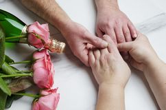 St. Valentine`s Day concept.Romantic dinner of old married couple.Closeup shot of hands stock photos
