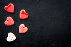 St Valentine`s Day cookies in shape of heart on black background top view copy space. St Valentine`s Day cookies in shape of heart on black background top view Stock Photography