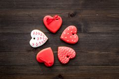St Valentine`s Day cookies in shape of heart on dark wooden background top view copy space. St Valentine`s Day cookies in shape of heart on dark wooden Royalty Free Stock Photography