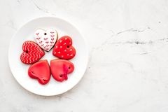 St Valentine`s Day cookies in shape of heart on plate on light grey background top view copy space. St Valentine`s Day cookies in shape of heart on plate on Royalty Free Stock Images