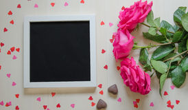 St Valentine`s Day empty mock up with pink roses and photo frame Stock Photos