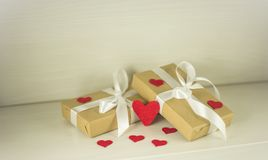 St Valentine`s Day, Gifts with heart. Gifts with white bow surrounded by colorful hearts. Special Valentine`s Day Royalty Free Stock Images