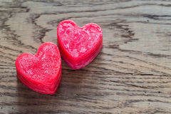 St. Valentine`s day heart-shaped candles Stock Photo