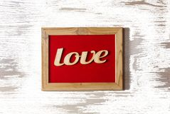 St. Valentine`s Day. Red frame with the inscription LOVE. Concept: Love. white texture Royalty Free Stock Photography