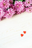 St. Valentine`s Day. Red hearts and chrysanthemum stock photos