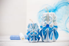 St. Valentine`s Day: two carved candles of blue color against the background heart. Royalty Free Stock Photos