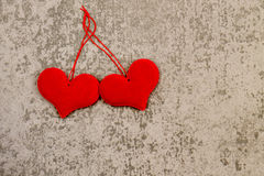 St. Valentine`s Day two red hearts on gray background Royalty Free Stock Image