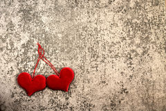 St. Valentine`s Day two red hearts on gray background Royalty Free Stock Photo