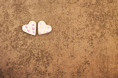 St. Valentine`s Day two rosy hearts on gray background Stock Photography