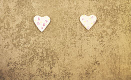 St. Valentine`s Day two rosy hearts on gray background Stock Images