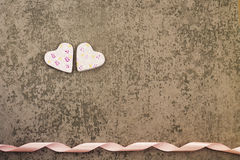 St. Valentine`s Day two rosy hearts on gray background Royalty Free Stock Photography