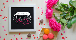 St Valentine`s Day vintage composition of white photo frame, pink roses bouquet Royalty Free Stock Photo