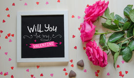 St Valentine`s Day vintage composition of white photo frame, pink roses bouquet Royalty Free Stock Images