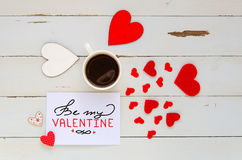 St Valentine`s Day vintage overhead composition of note with greeting. St Valentine`s Day vintage overhead composition of note with hand lettered greeting Royalty Free Stock Images