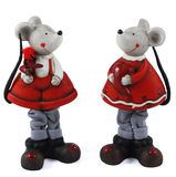 St. Valentine's mice girls. Photo of the statuettes on white background. Two sweetly mouse in red-white clothes with heart and flower stock photos