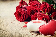 St Valentine's setting with bouquet of red roses Stock Photo