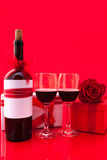 St Valentine`s setting with present and red wine Stock Photos