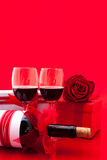 St Valentine`s setting with present and red wine Royalty Free Stock Images