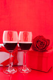 St Valentine`s setting with present and red wine Stock Images