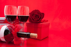 St Valentine`s setting with present and red wine Royalty Free Stock Photography