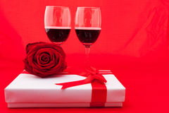 St Valentine`s setting with present and red wine Royalty Free Stock Image
