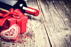 St Valentine's setting with present and red wine Royalty Free Stock Photos